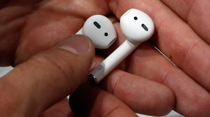 Apple AirPods are displayed during a media event in San Francisco.