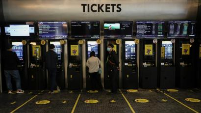 People buy movie tickets with self-ticketing machines at Golden Screen Cinemas, as cinemas reopen amid the coronavirus disease (COVID-19) outbreak, in Kuala Lumpur, Malaysia.