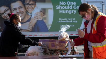 The Los Angeles Regional Food Bank distributes food outside a church.