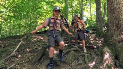 Girls from Cub Scout Den 13, in the woods
