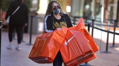 A woman carries Nike shopping bags at the Citadel Outlet mall, as the global outbreak of the coronavirus disease (COVID-19) continues, in Commerce, California, U.S.
