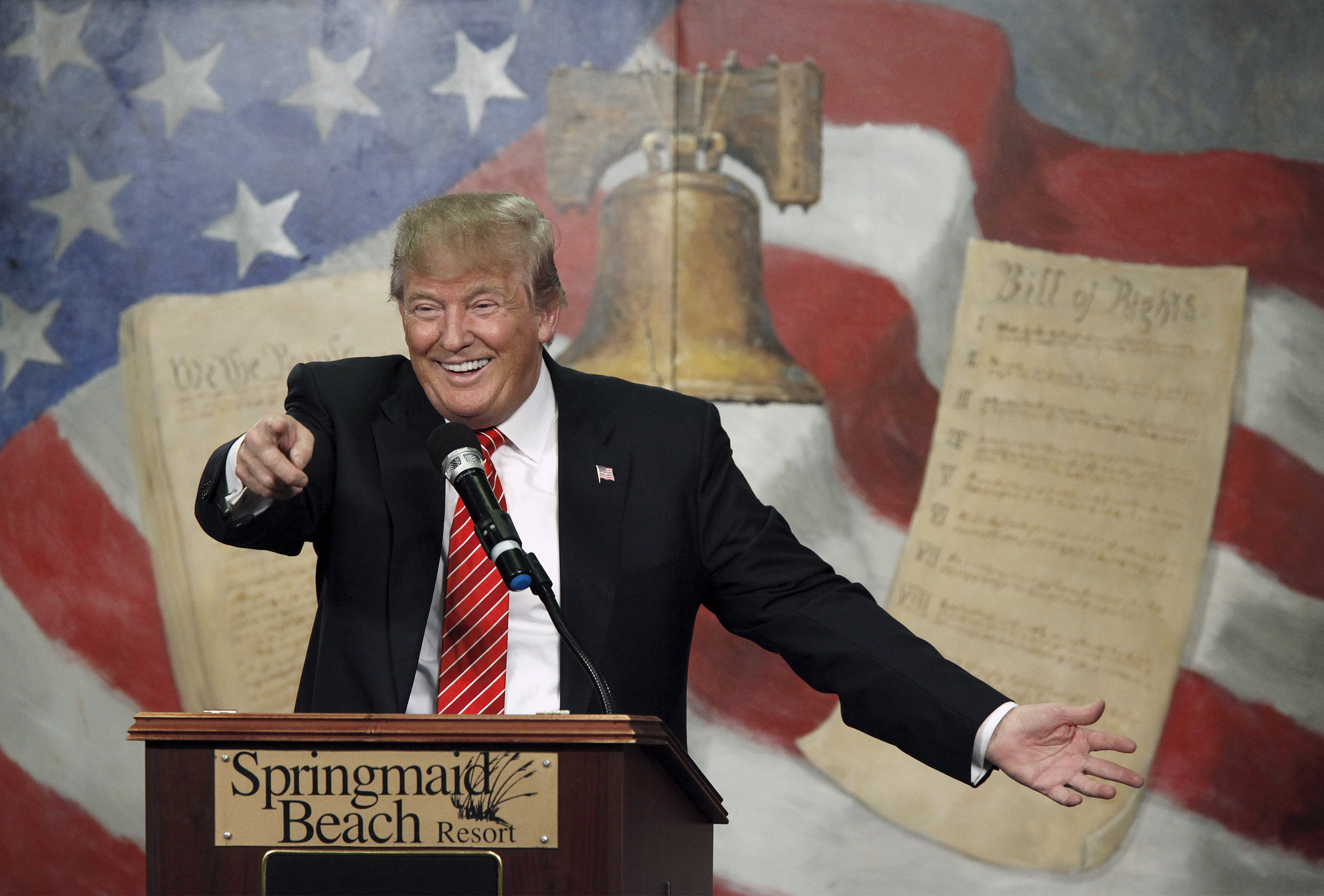 Donald Trump speaks in front of a poster of the US' founding documents