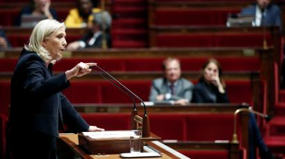 Marine Le Pen, member of parliament and leader of French far-right National Rally (Rassemblement National) party, delivers a speech during a debate on migration at the National Assembly in Paris