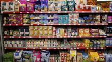 Rows and rows of pet food in a supermarket