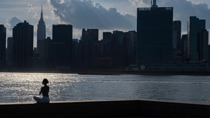 A woman meditates in New York.