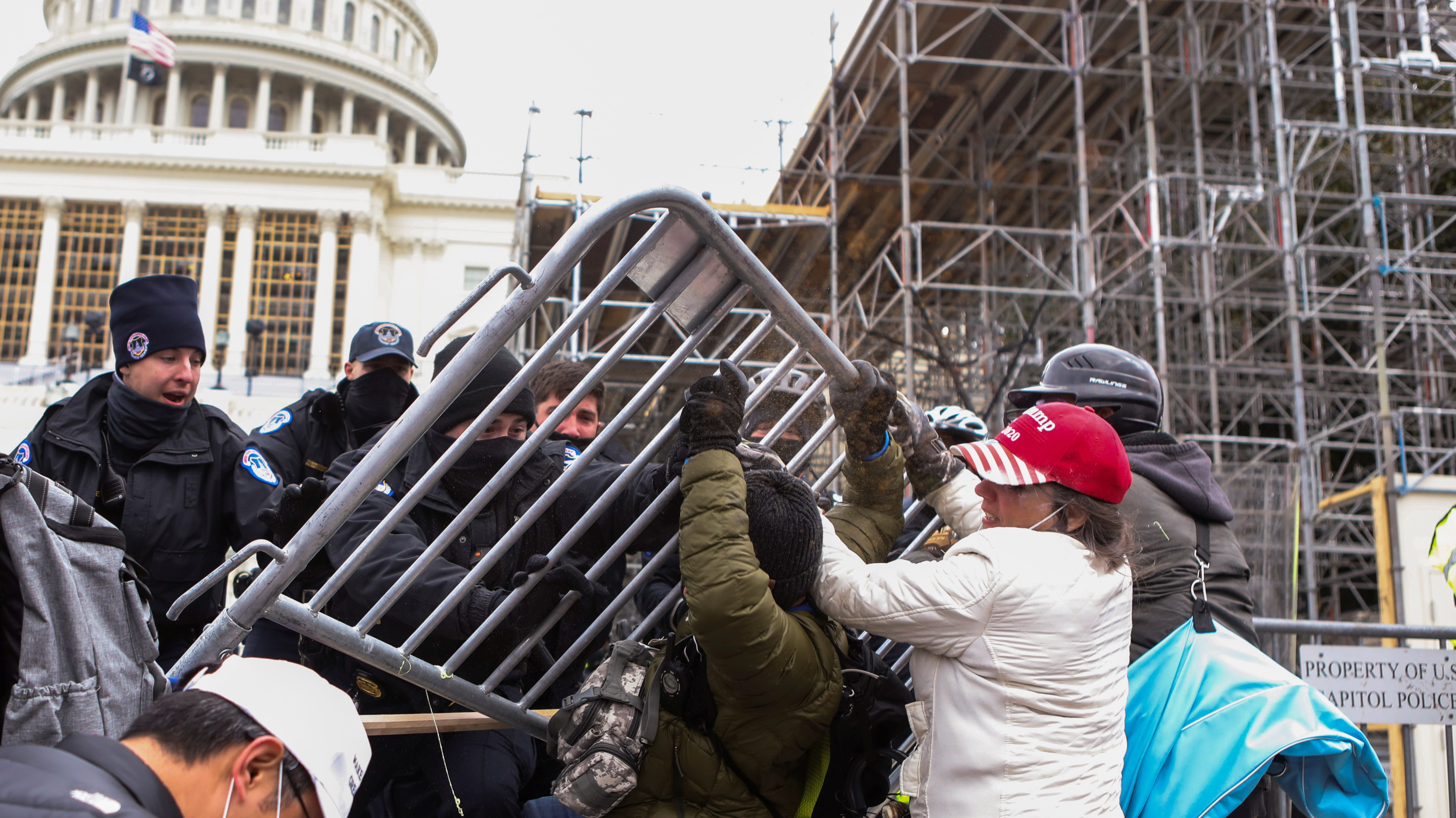 Law enforcement officers push back against supporters of U.S. President Donald Trump attempting to enter U.S. Capitol during a protest against the certification of the 2020 U.S. presidential election results by the U.S. Congress