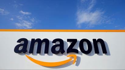 Amazon's logo looming large against the sky