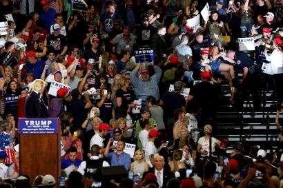 Donald Trump looks back at the crowd at an election rally.