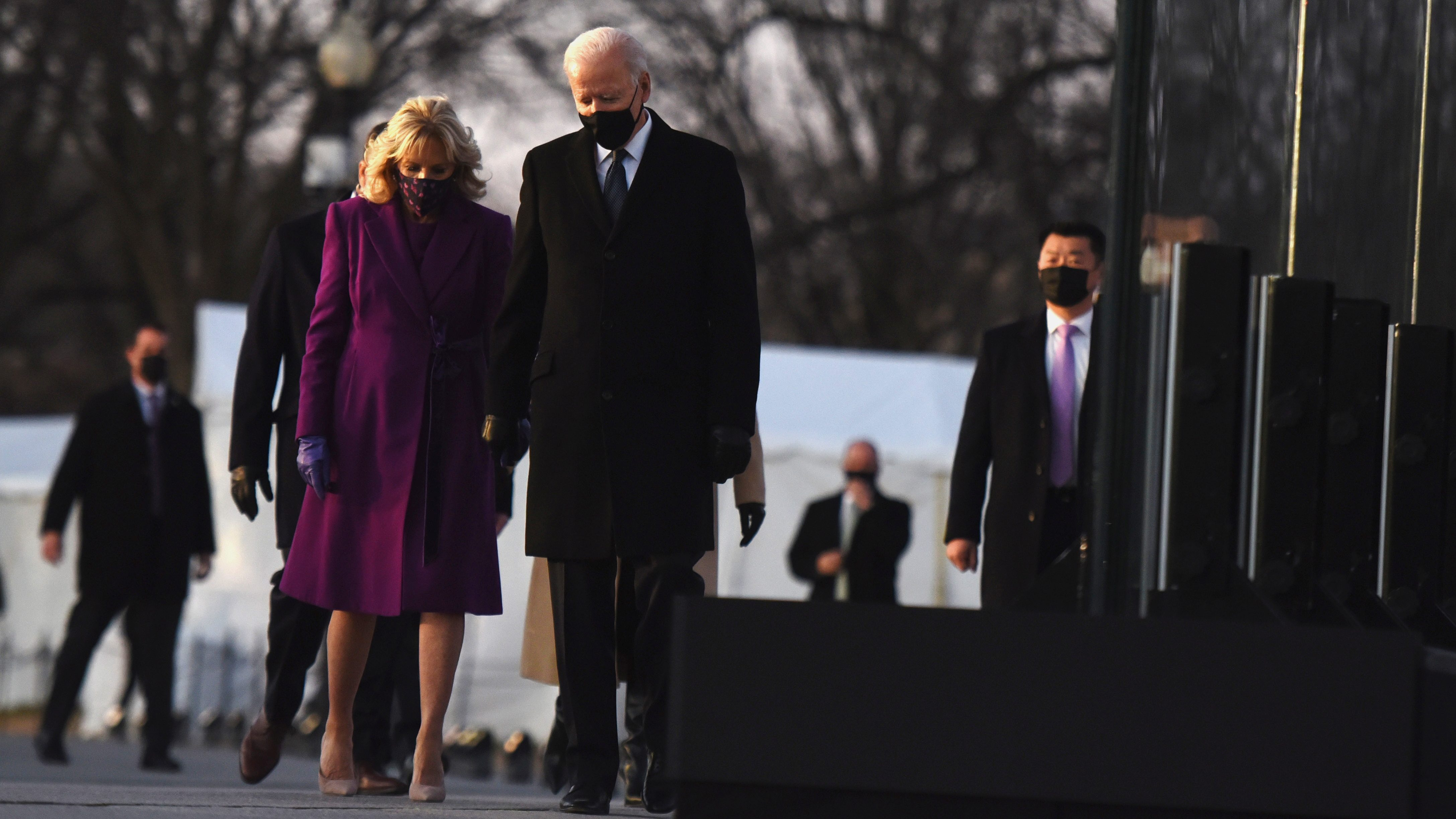 Joe and Dr. Jill Biden walk on the national mall after a memorial service to all those who died in the Covid-19 pandemic so far.
