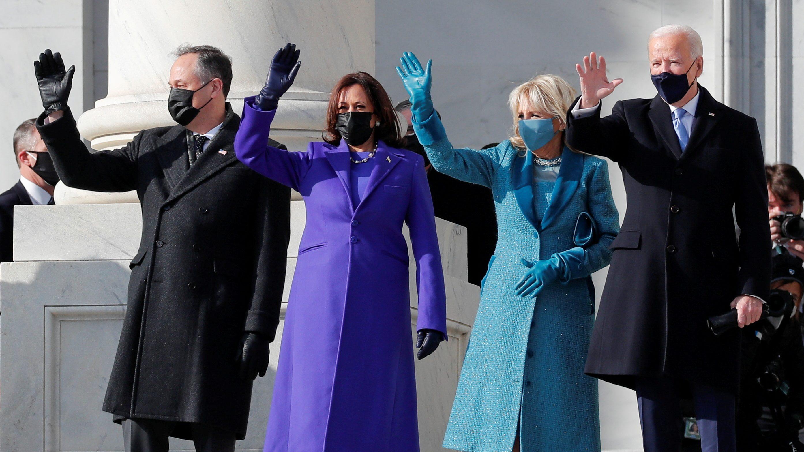 President-elect Joe Biden, his wife Jill Biden, Vice President-elect Kamala Harris and her husband Doug Emhoff salute as they arrive ahead of the inauguration in Washington