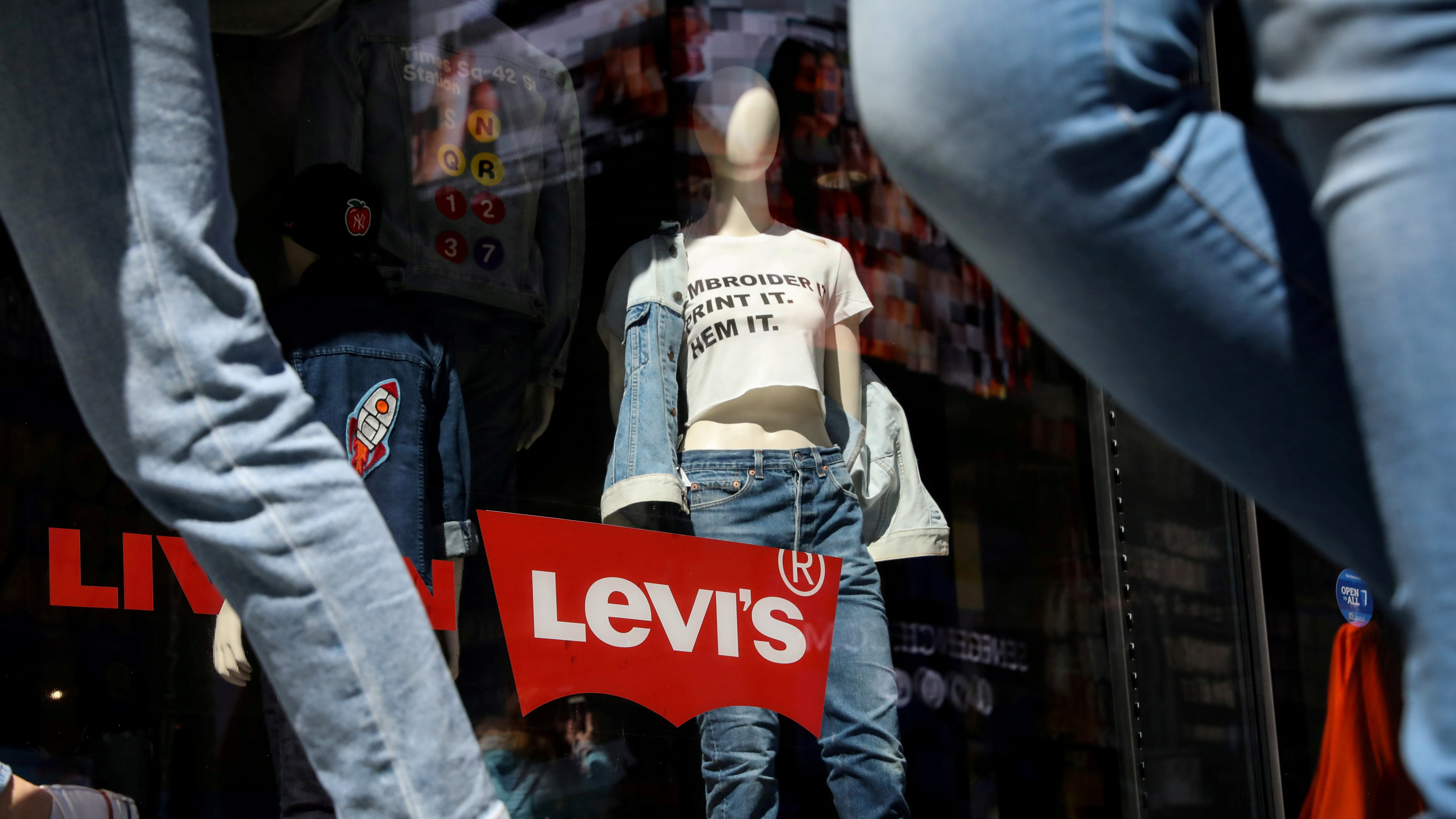People pass by a Levi Strauss store in New York City