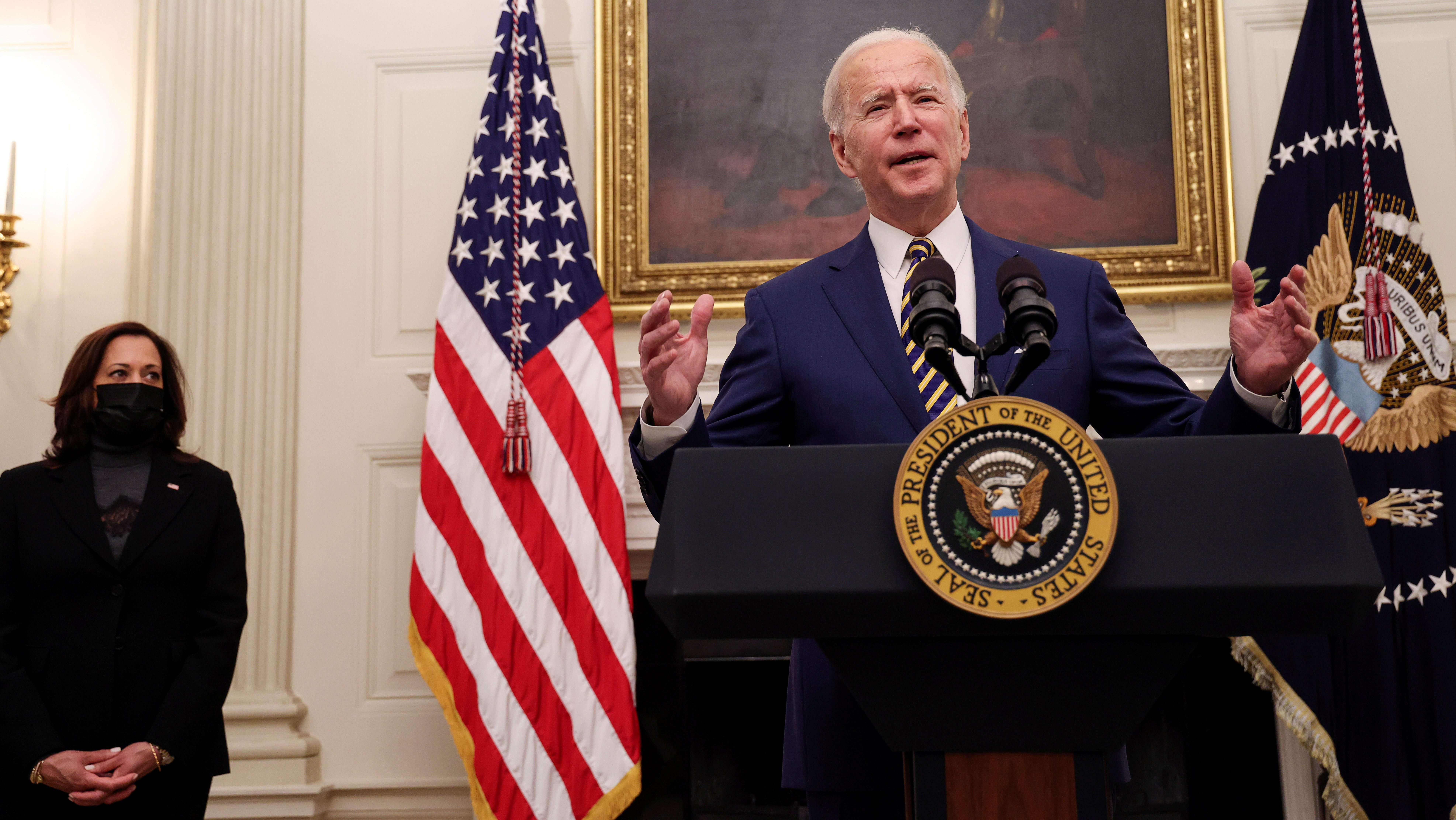 U.S. President Joe Biden speaks about his administration's plans to respond to the economic crisis as Vice President Kamala Harris listens during a coronavirus disease (COVID-19) response event in the State Dining Room at the White House in Washington, U.S., January 22, 2021. R