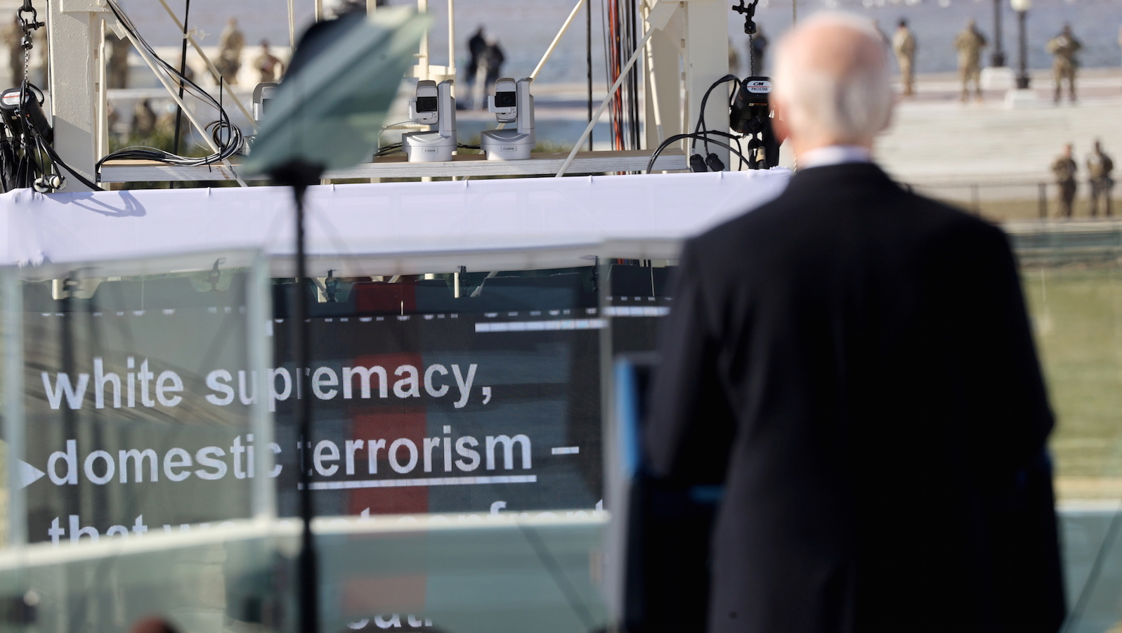 """Biden faces a monitor with the word """"white supremacy"""" during his inaugural speech"""
