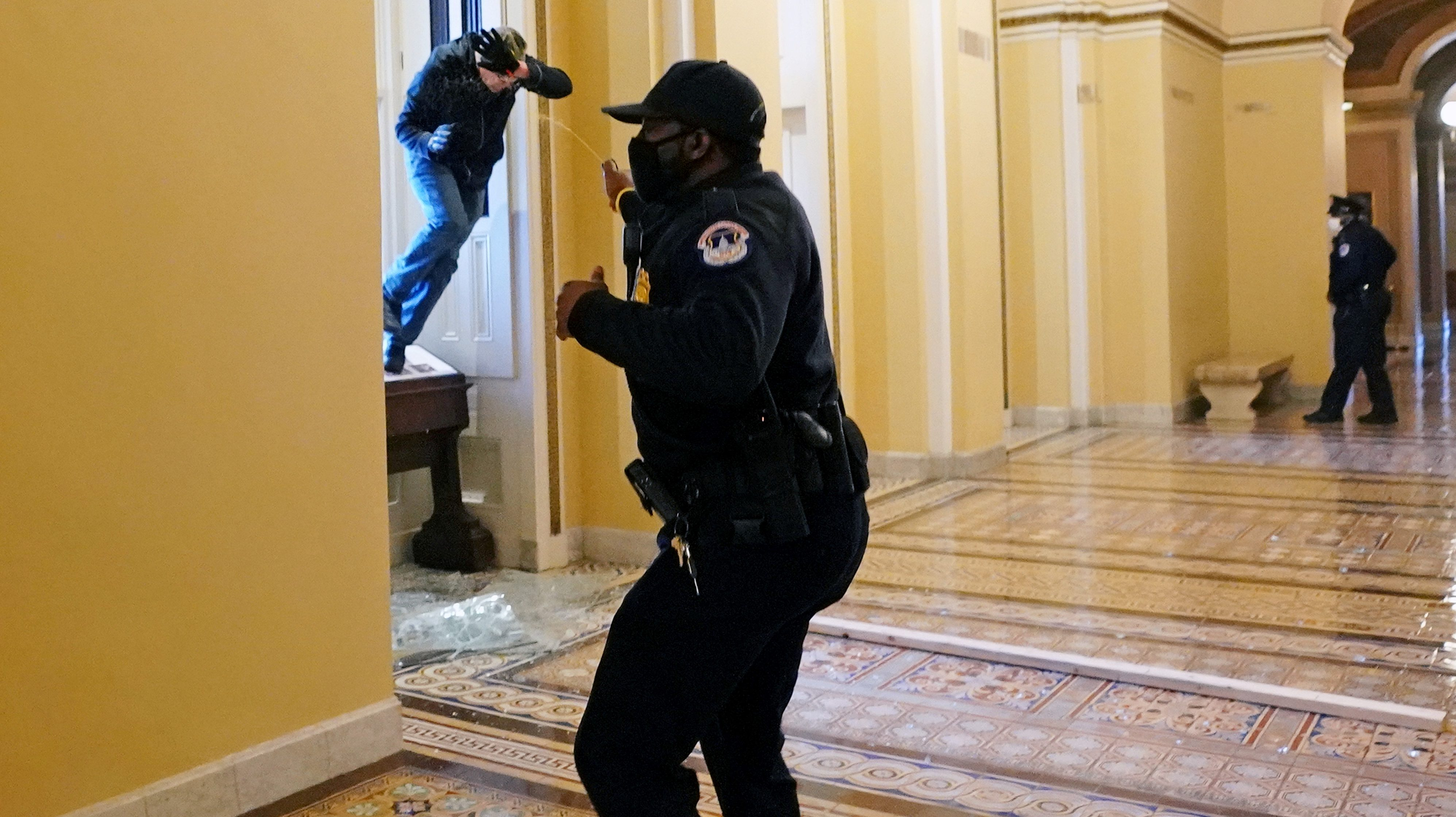 A U.S. Capitol police officer shoots pepper spray at a protestor attempting to enter the Capitol building during a joint session of Congress to certify the 2020 election results on Capitol Hill in Washington, U.S., January 6, 2021.