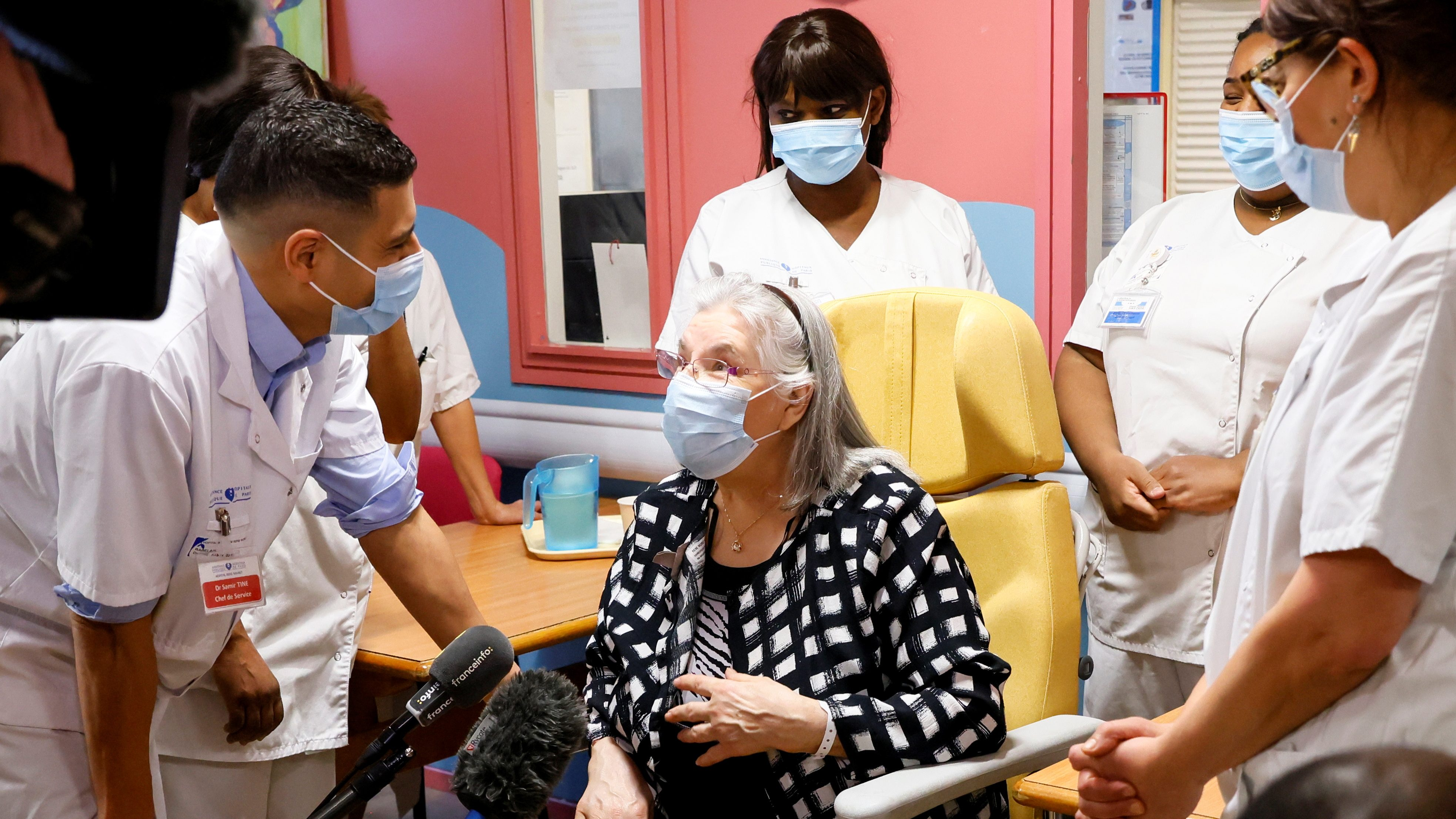 A 78-year-old French woman speaks with medical staff