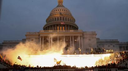 An explosion is seen in front of the US Capitol building.