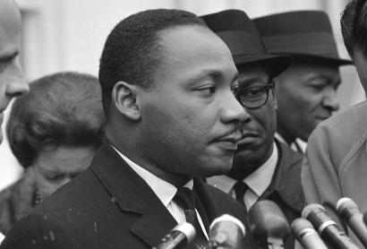 Martin Luther King Jr. speaks after meeting with President Lyndon B. Johnson to discuss civil rights at the White House in Washington, U.S., December 3, 1963.
