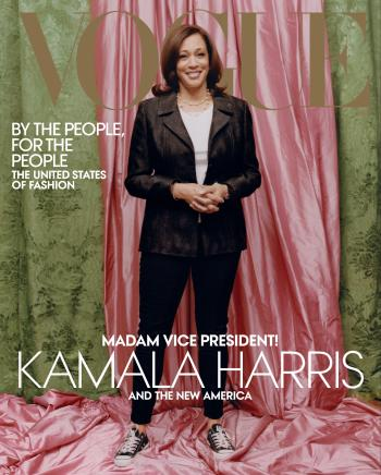 Kamala Harris in a Donald Deal blazer and black Chuck Taylor sneakers in front of a pink and green backdrop on the cover of Vogue.