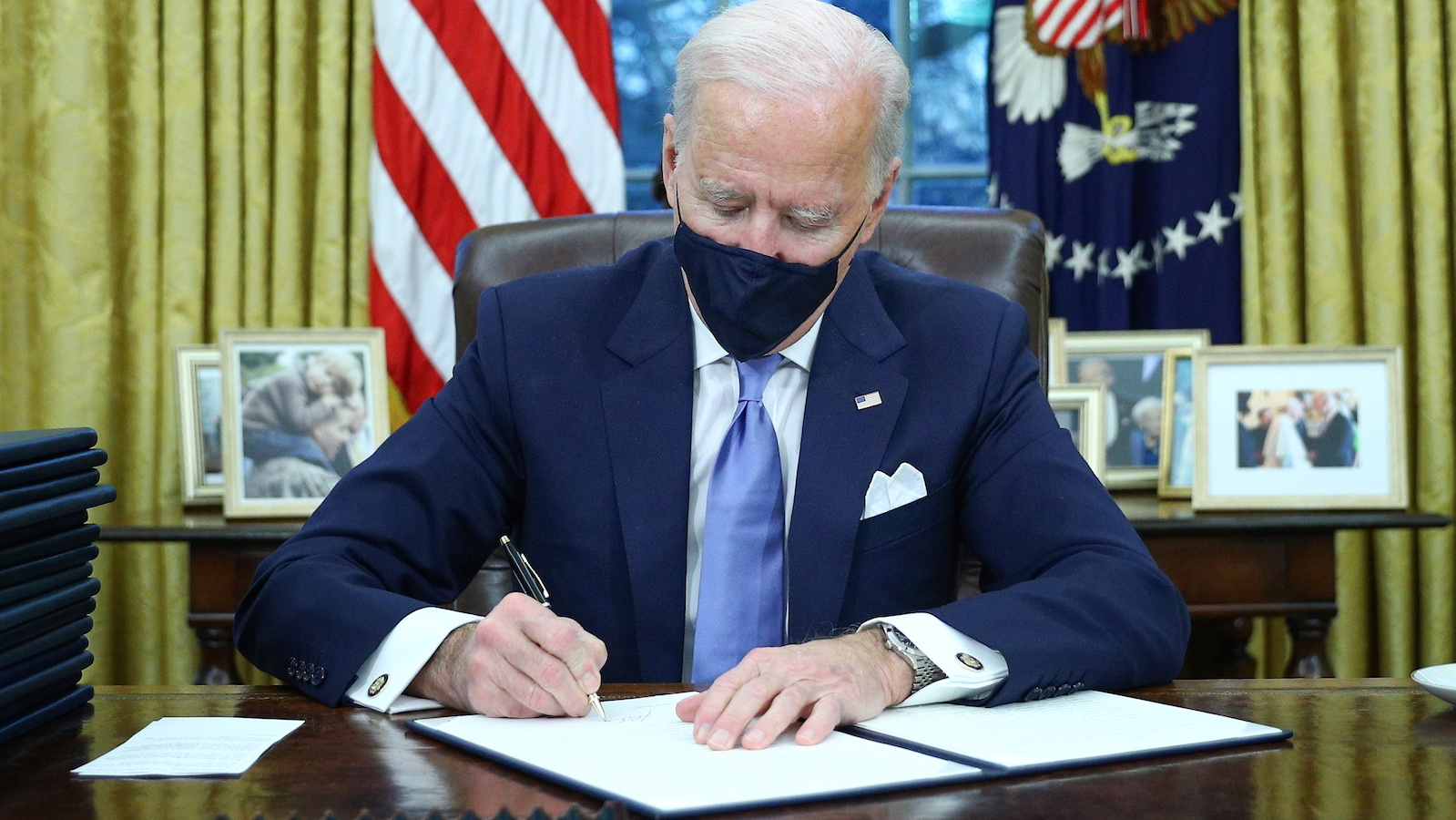 Biden signs executive orders on his first day in the White House