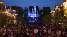 People walk on Main Street during Disneyland's Diamond Celebration in Anaheim