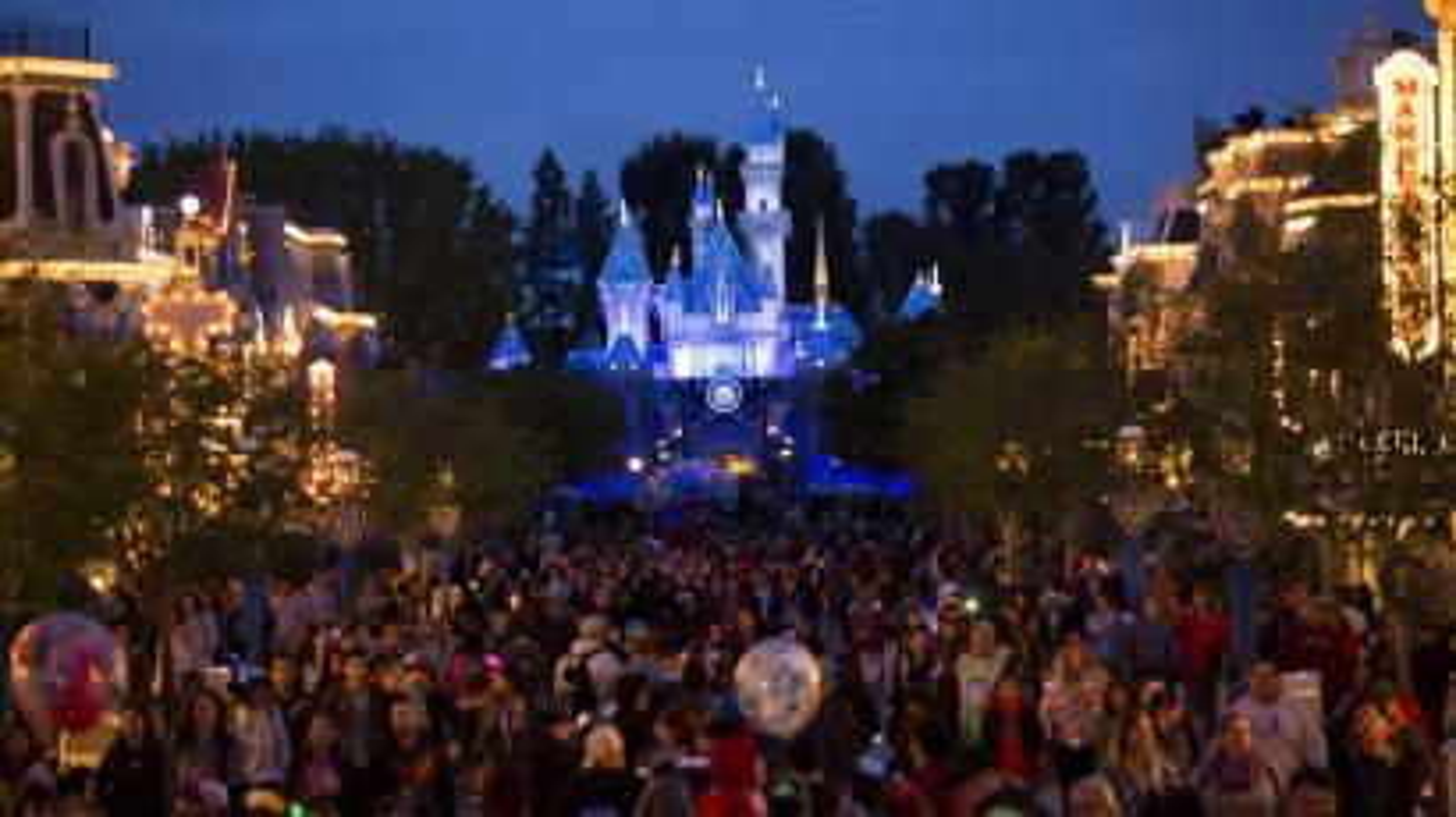 People walk on Main Street during Disneyland's Diamond Celebration in Anaheim