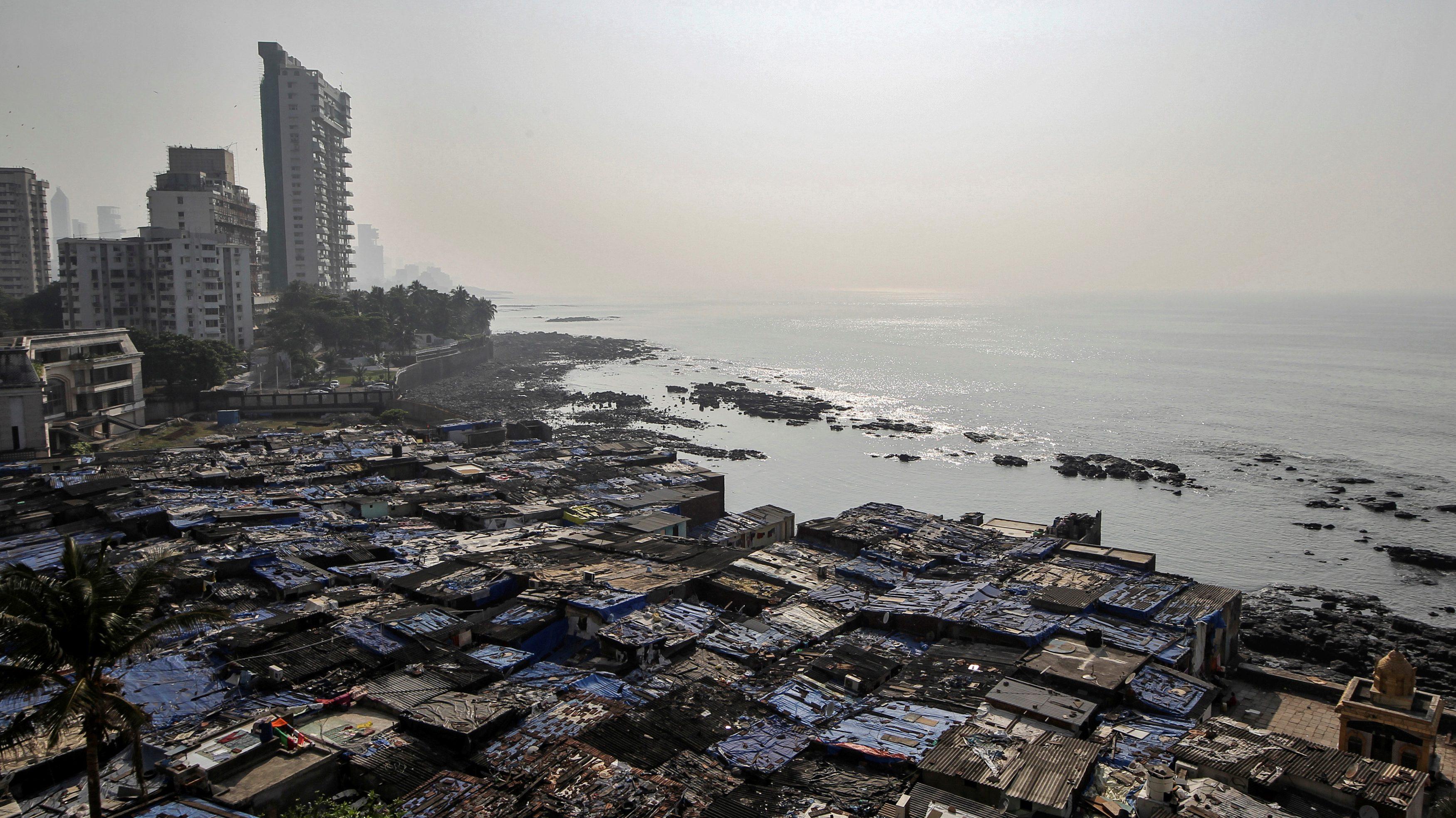 A view of a slum is seen along a seashore in Mumbai