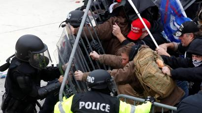 Pro-Trump protesters tear down a barricade as they clash with Capitol police during a rally to contest the certification of the 2020 U.S. presidential election results by the U.S. Congress, at the U.S. Capitol Building in Washington, U.S, January 6, 2021.