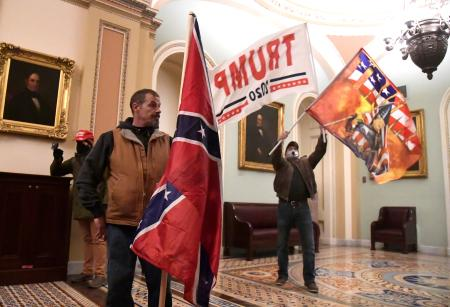 Supporters of U.S. President Donald Trump demonstrate on the second floor of the U.S. Capitol near the entrance to the Senate after bre?ching security defenses, in Washington, U.S., January 6, 2021.