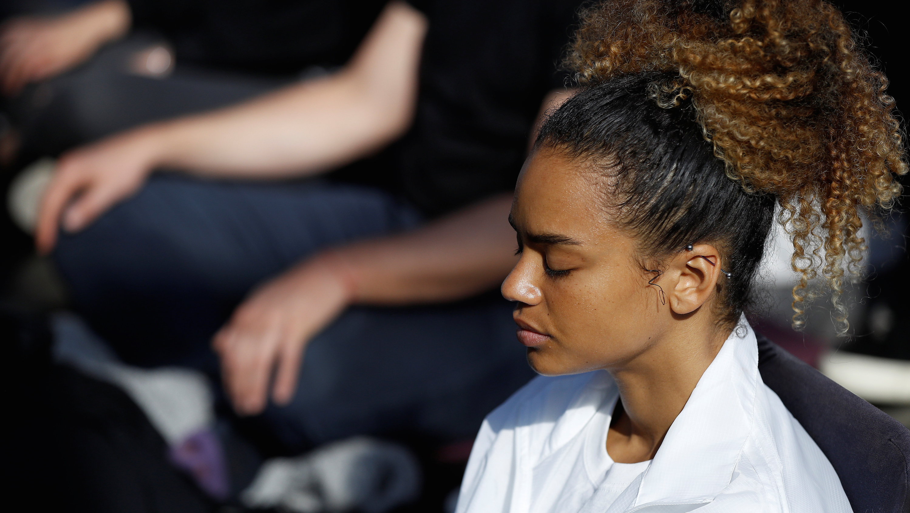 close-up of woman with eyes closed meditating