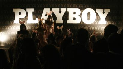 People attend a Playboy magazine party sponsored by a whiskey brand