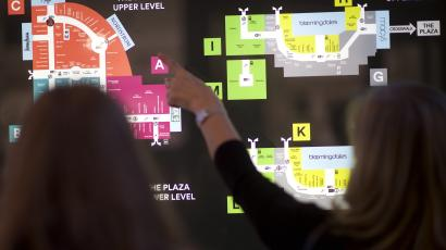 Two female shoppers refer to a map of a mall layout at the King of Prussia Mall in this archival photo.