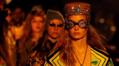 Models present a creation by designer Alessandro Michele as part of his 2019 Cruise collection show for fashion house Gucci
