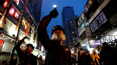 Demonstrators protesting the proposed extradition bill aim their flashlights towards riot police as they are chased through the streets of Hong Kong, China, August 25, 2019.