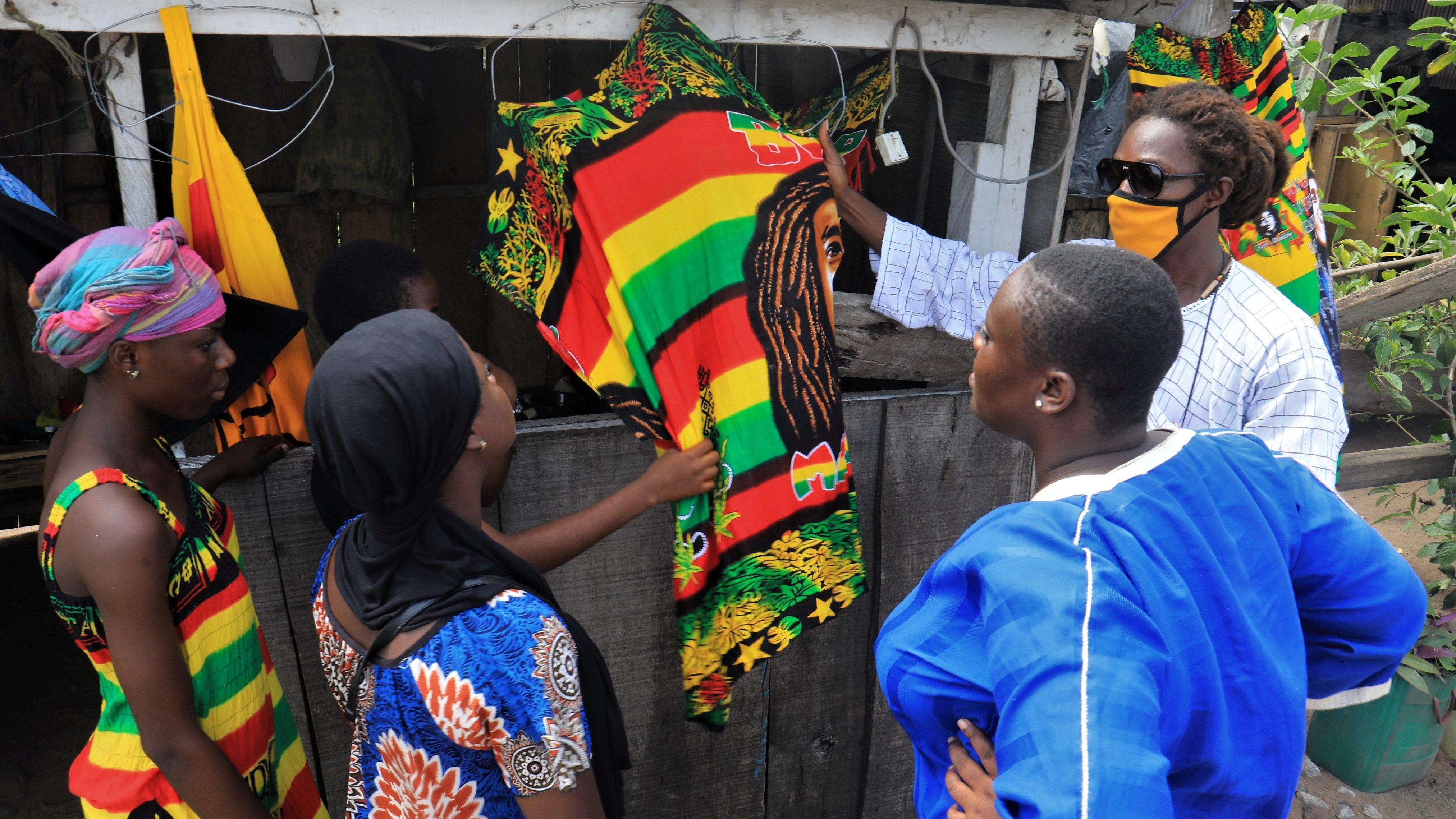Shoppers examine wares in Abidjan at the outbreak of the coronavirus disease.