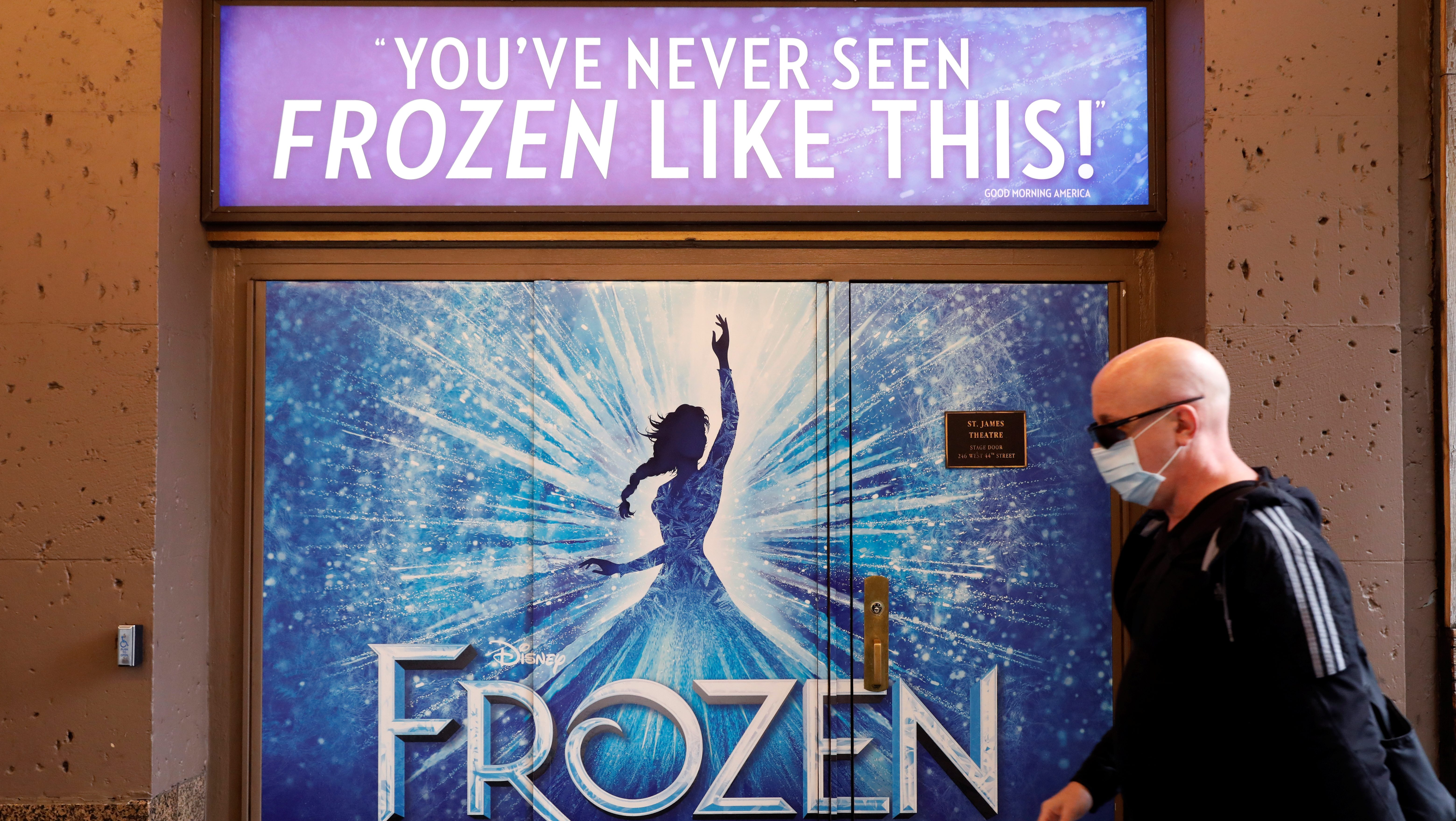 A person walks by the St. James Theatre where Disney's Broadway production of Frozen the Musical was being shown and has now been canceled due the outbreak of the coronavirus disease (COVID-19) in Manhattan, New York City, U.S., May 15, 2020.