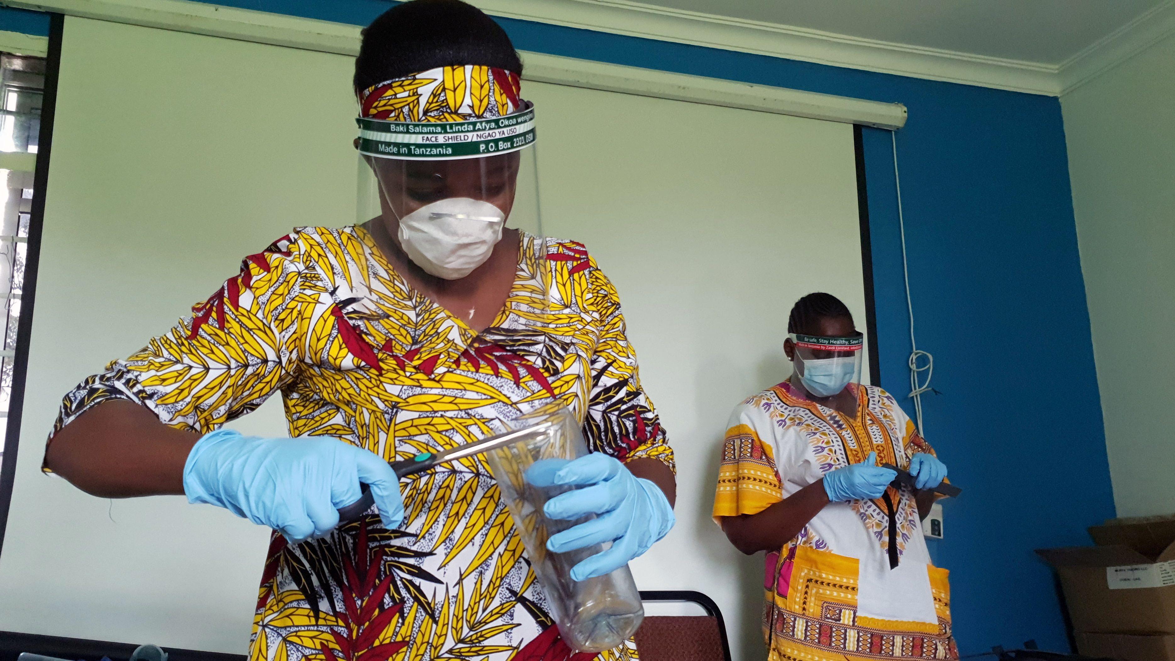 Workers prepare face shields in Dar es Salaam last May.