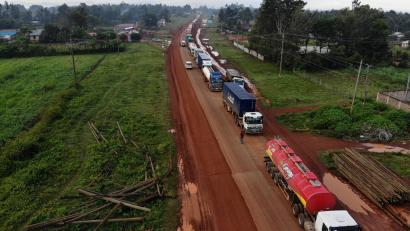 Parked trucks wait in a 10km queue to cross the Kenyan-Ugandan border from the town of Busia, Kenya November 14, 2020.
