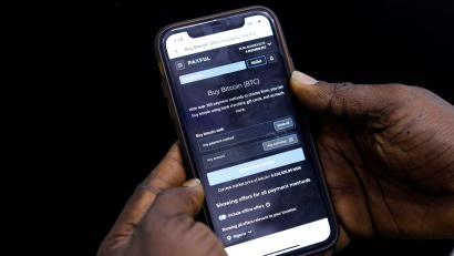Abolaji Odunjo, a gadget vendor who trades with bitcoin, demonstrates a bitcoin application on his mobile phone in Lagos, Nigeria August 31, 2020.