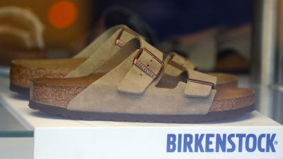 A pair of shoes is pictured in a window of a Birkenstock footwear store in Berlin