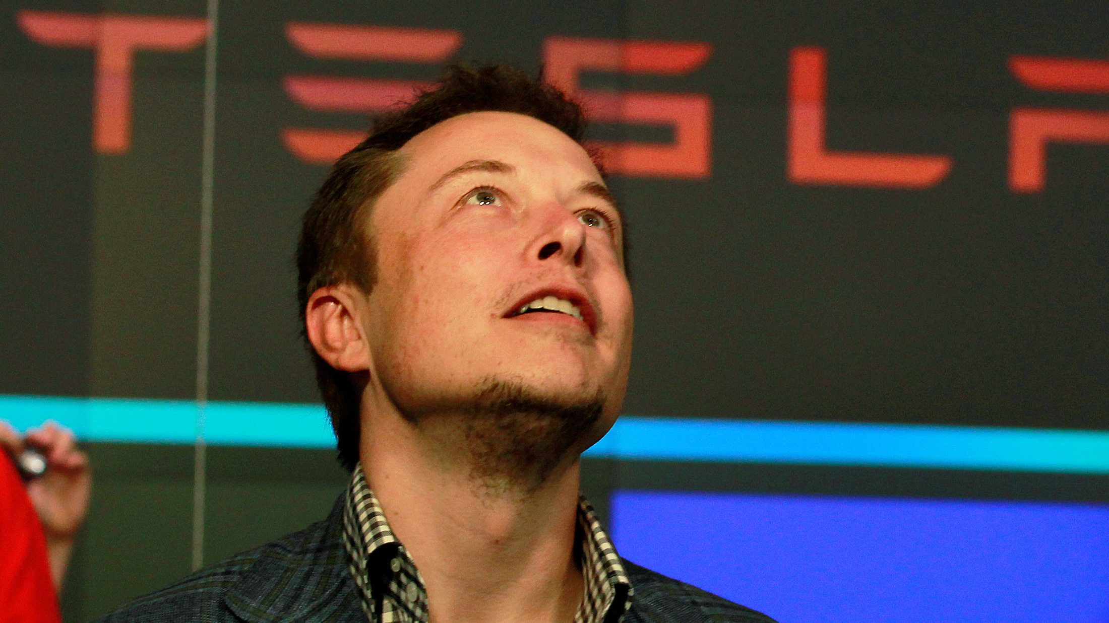 CEO of Tesla Motors Elon Musk reacts following the company's initial public offering at the NASDAQ market in New York June 29, 2010.