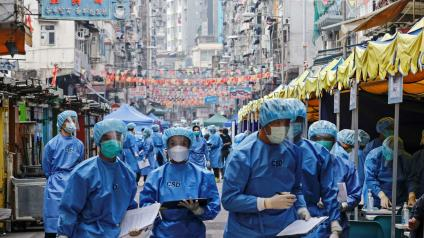 Health workers are seen in protective gear inside a locked down portion of the Jordan residential area to contain a new outbreak of the coronavirus disease (COVID-19), in Hong Kong.