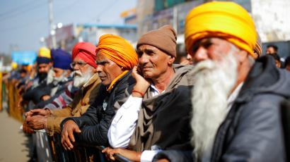 Farmers listen to a speaker during a protest against the farm laws at Singhu border near New Delhi, India, January 30, 2021.
