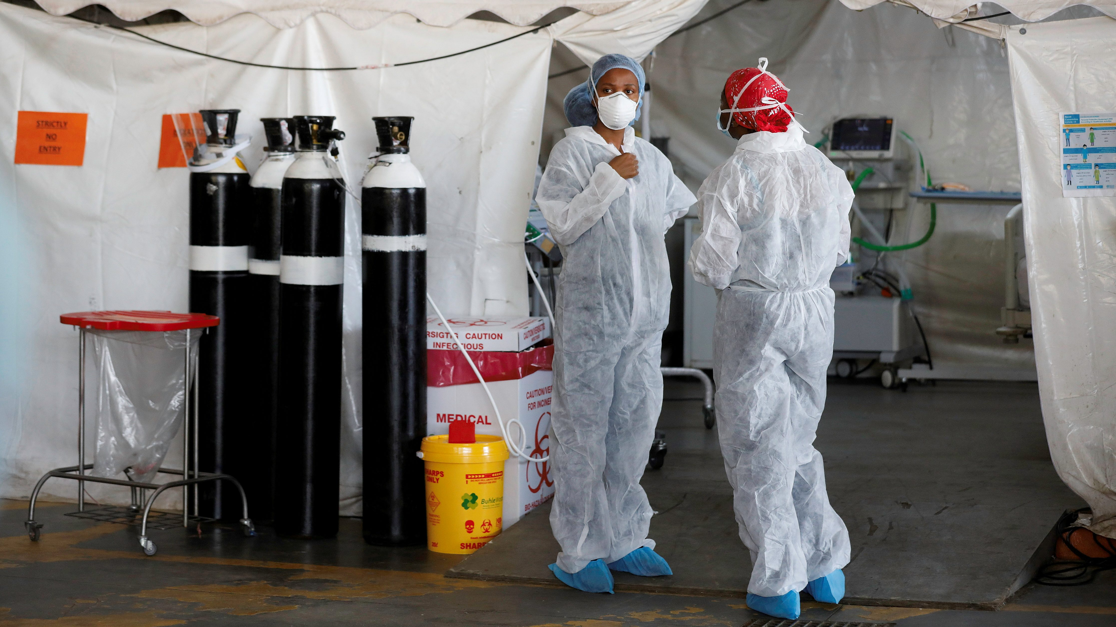 Healthcare workers chat at a temporary ward set up during the coronavirus disease (COVID-19) outbreak, at Steve Biko Academic Hospital in Pretoria, South Africa, January 19, 2021.