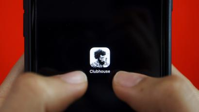 The Clubhouse app icon features Black musician Bomani X grinning at his guitar