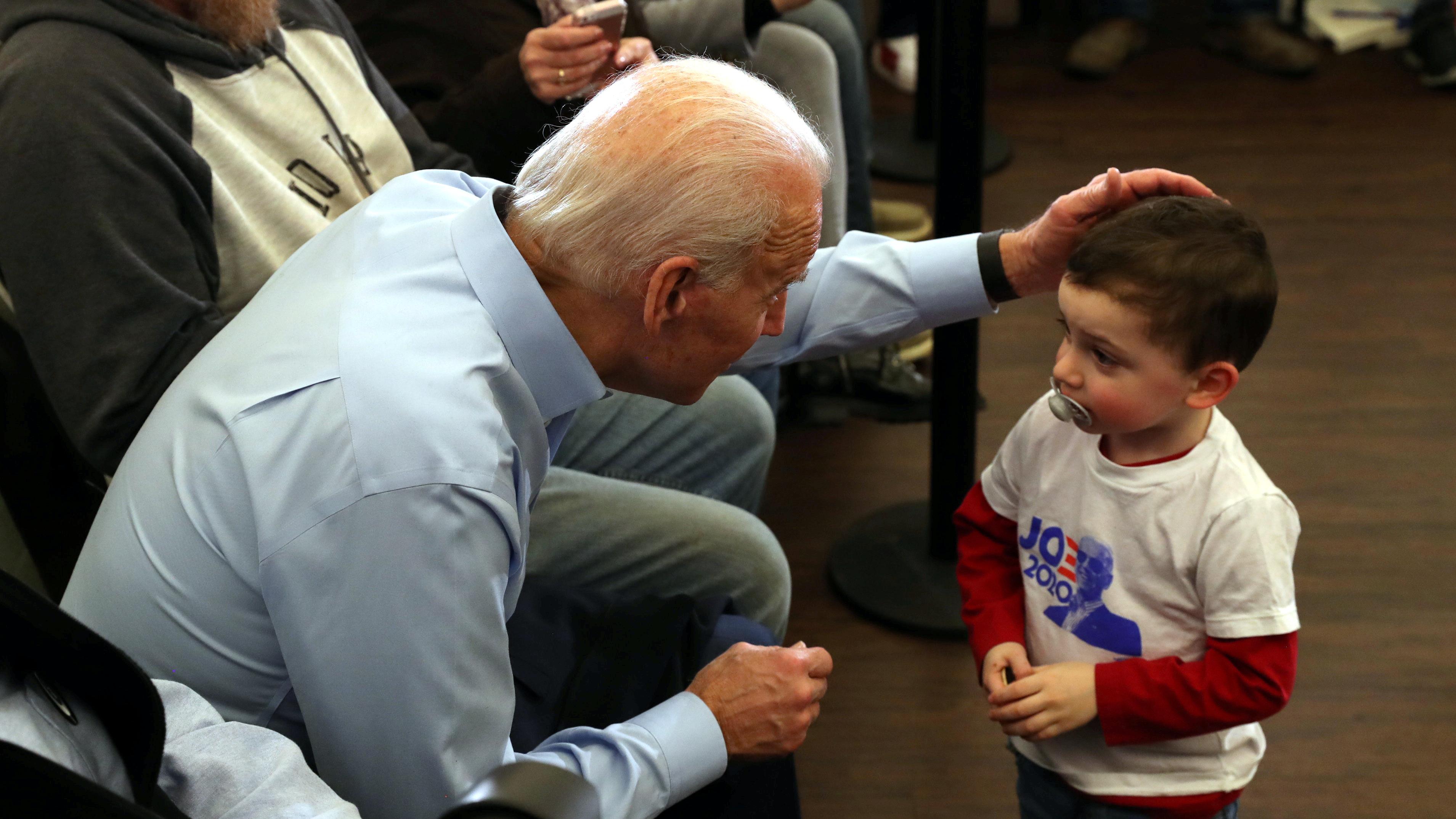 Joe Biden talks to a child at a campaign event