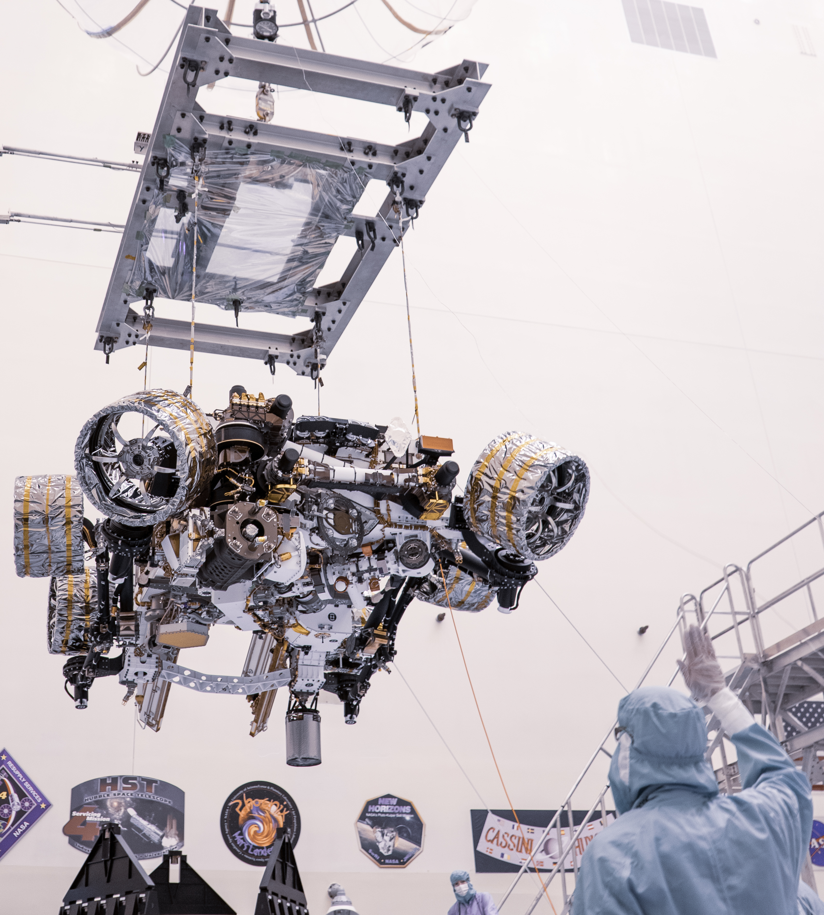 Engineers perform mass properties testing on NASA's Mars Perseverance rover inside Kennedy Space Center
