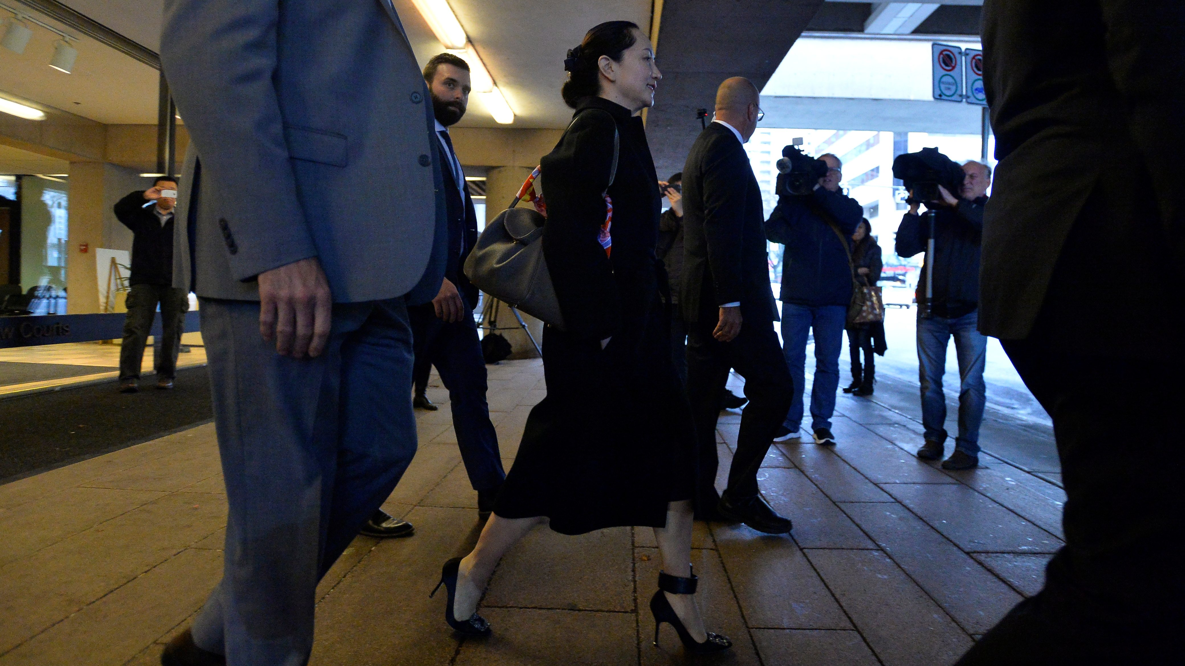Meng Wanzhou walks out of court wearing an ankle monitor