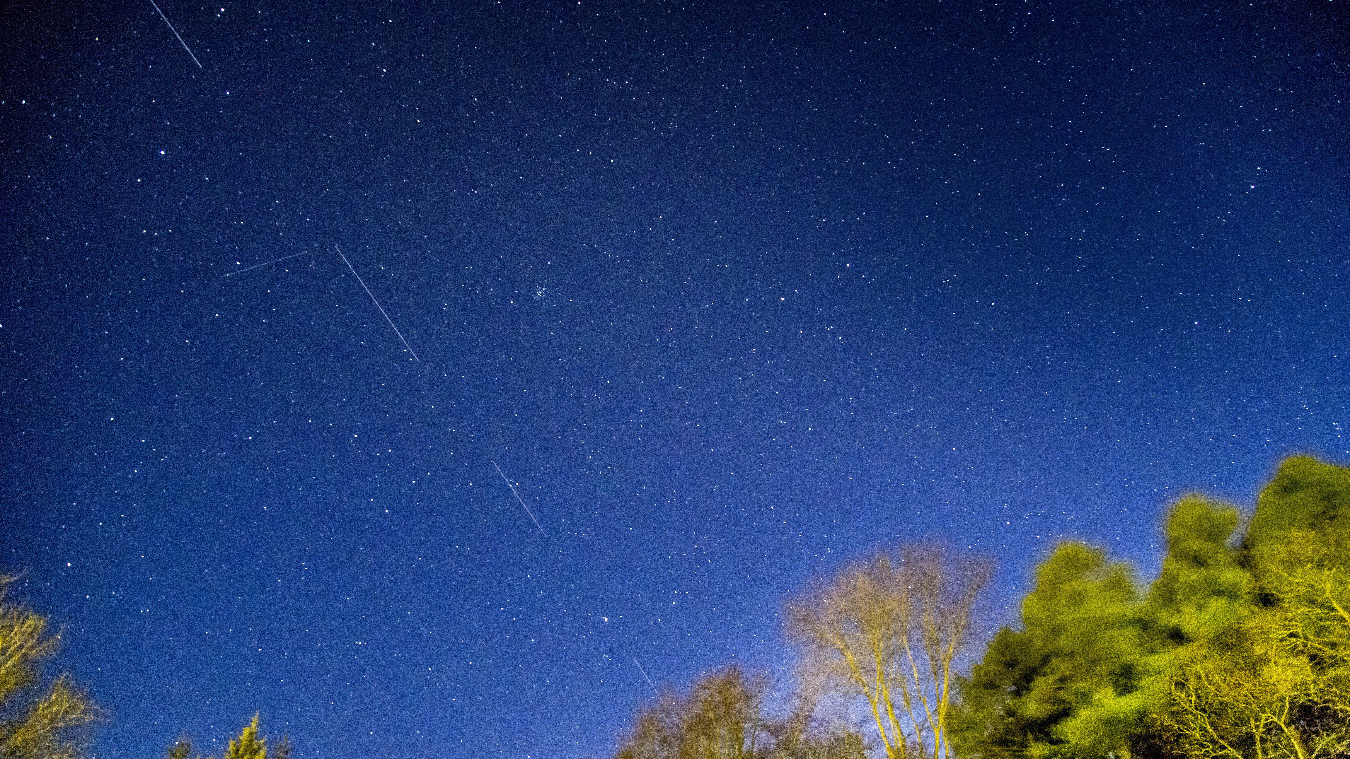 A long exposure shows Starlink satellites flying overhead in April 2020.