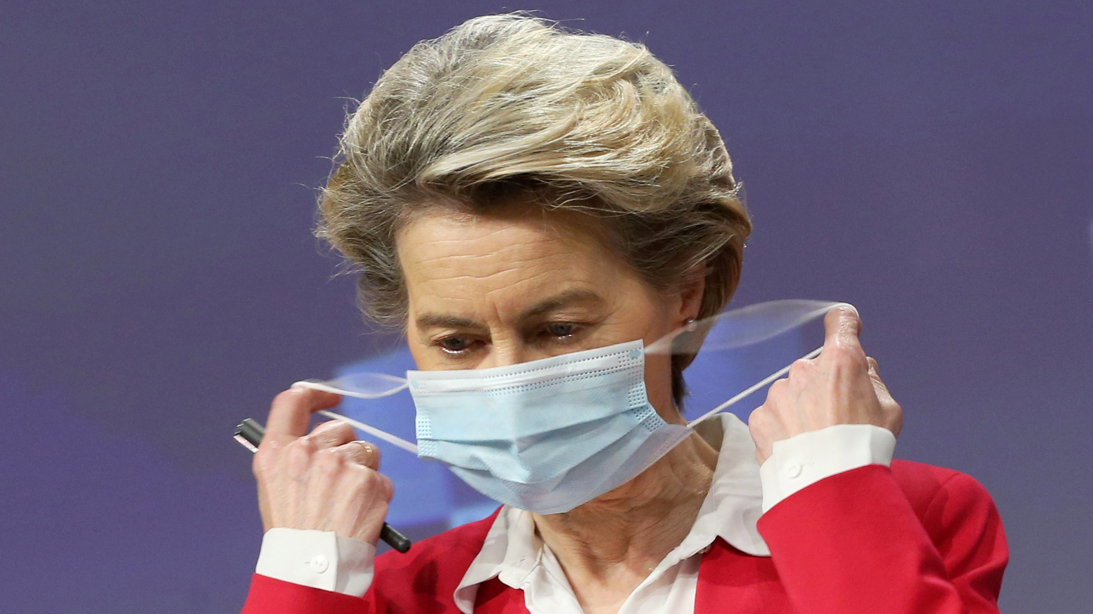 European Commission president Ursula Von Der Leyen removes her protective face mask