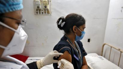 A photo of an Indian healthcare worker getting a vaccine.